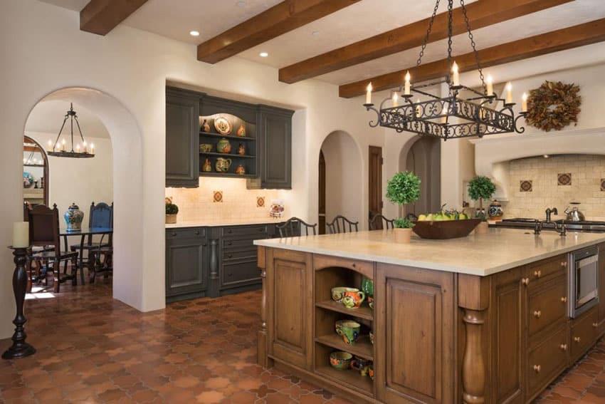 Mediterranean kitchen with terra cotta flooring and limestone countertops