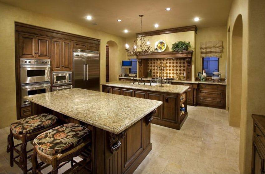 Mediterranean kitchen with travertine floor tiles and beige granite island