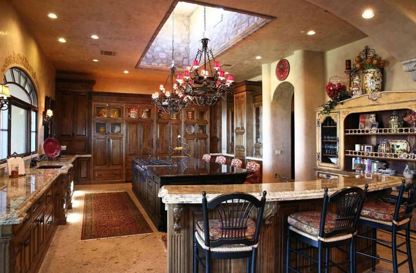 Mediterranean kitchen with two types of granite counters and two islands