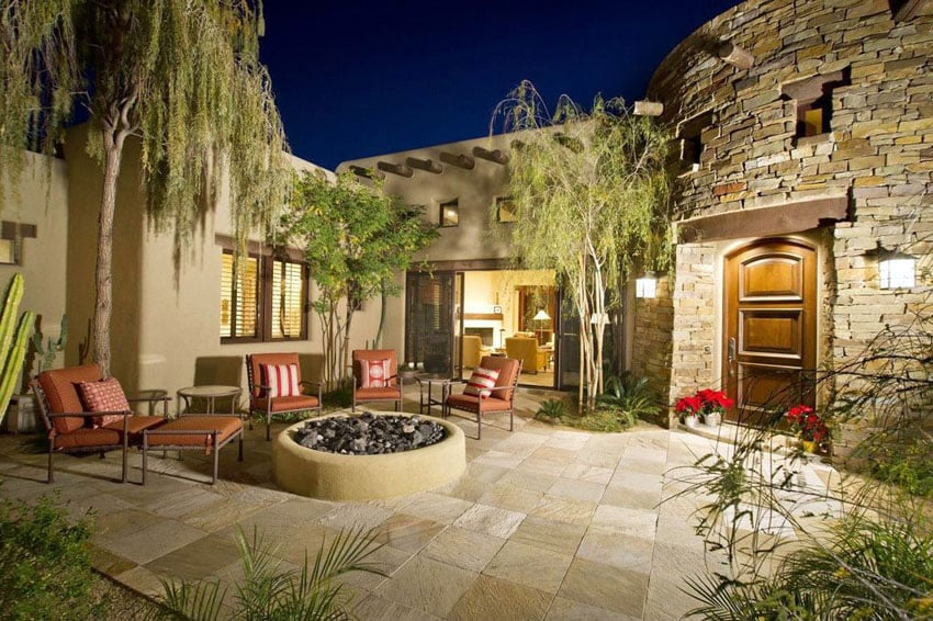 Mediterranean style patio with round stucco fire pit