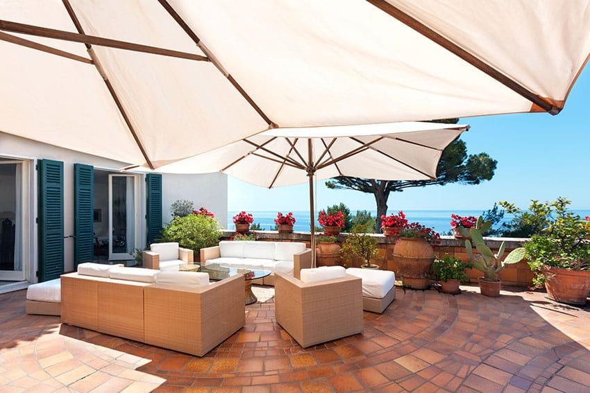 Mediterranean style stone tile patio with ocean views