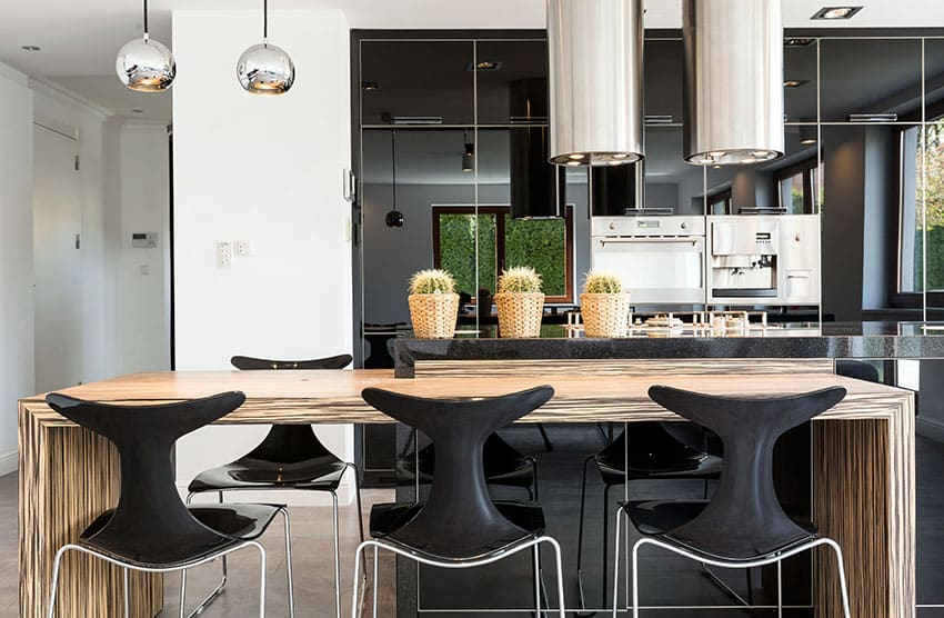Modern black cabinet kitchen with wood grain island and chrome lighting