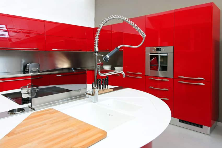 modern-kitchen-with-european-style-red-cabinets-and-white-countertop