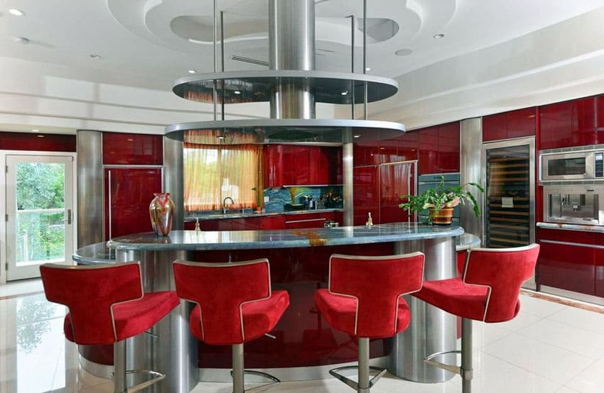 modern-kitchen-with-red-cabinets-and-gray-granite-counter-with-breakfast-bar-island