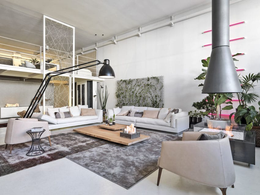 Modern living room open to loft room with cone shaped fireplace