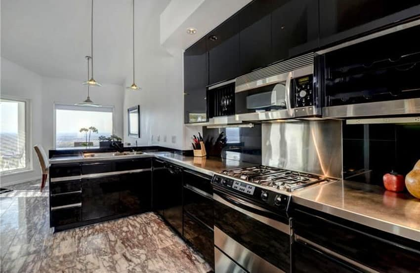 One wall black cabinet kitchen with pendant lights
