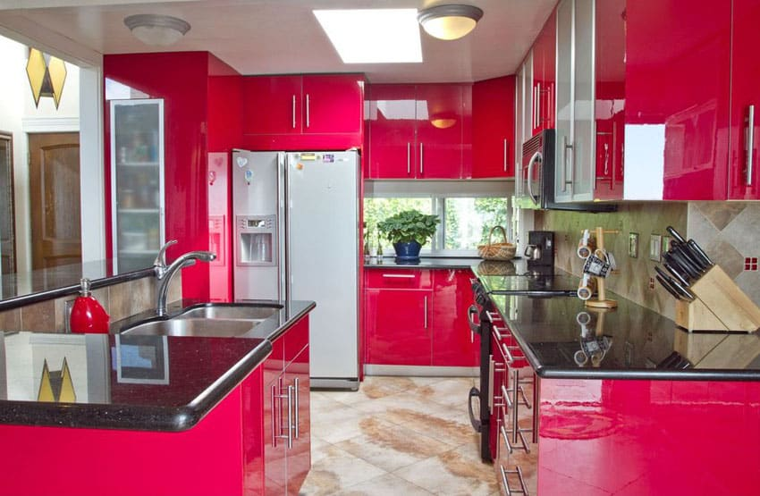 pink-modern-kitchen-with-black-corian-countertops