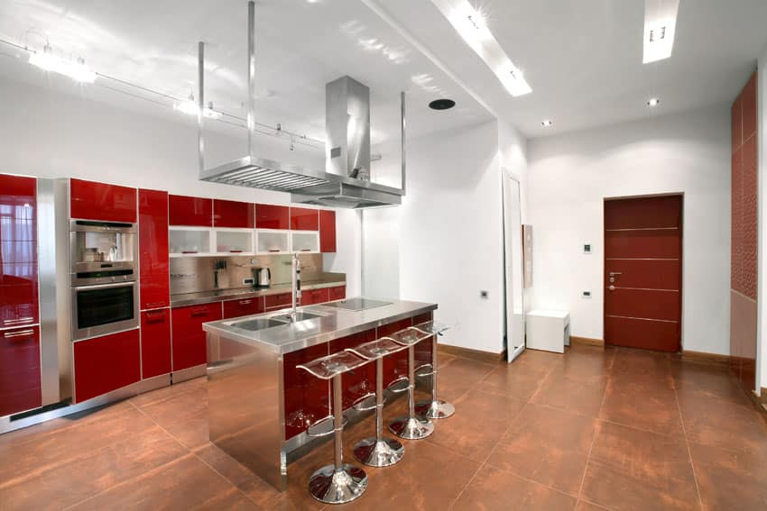 red-cabinet-kitchen-with-stainless-steel-countertops-and-breakfast-bar-island