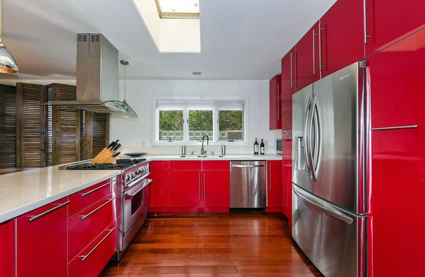 red-modern-kitchen-with-acrilux-cabinets-and-maple-flooring