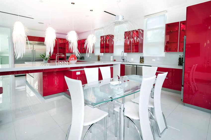 Red modern kitchen with white corian countertop and feather pendant lights