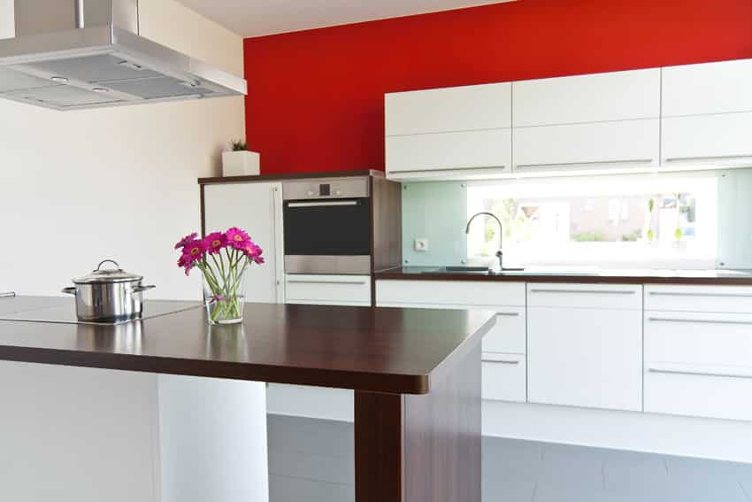 red-wall-kitchen-with-white-cabinets