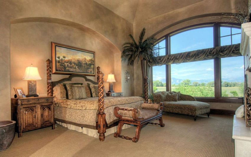 Rustic Mediterranean style bedroom with tan painted walls and arched window