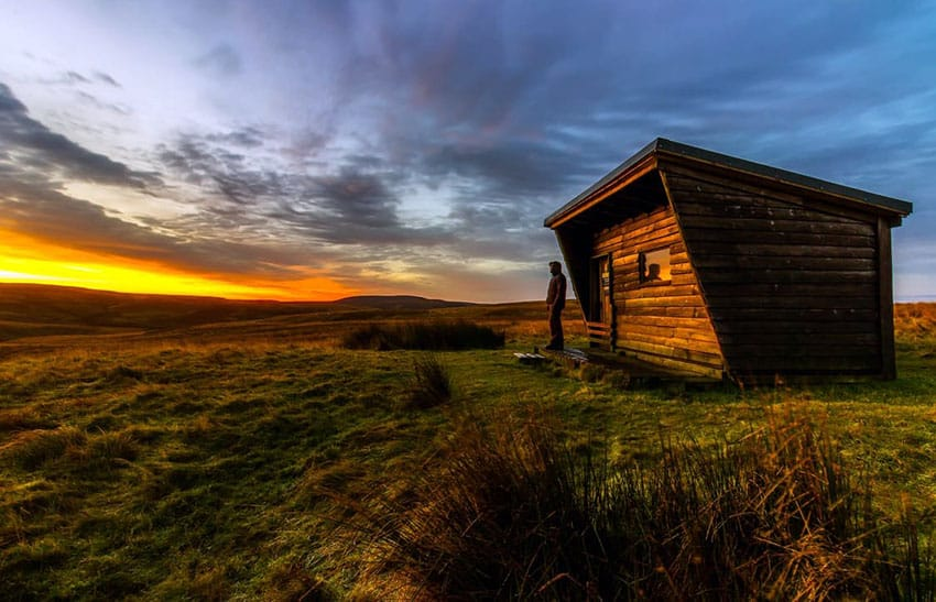 Rustic wood tiny house with flat slanted roof