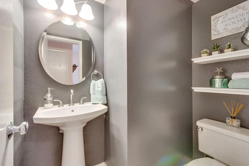 Small bathroom powder room with white shelving