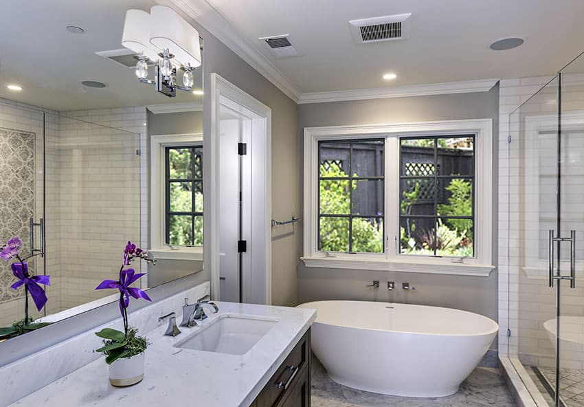 Beautiful bathroom with soft color theme and freestanding tub