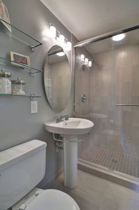 Small contemporary bathroom with pedestal sink porcelain tile floor0and glass shelving