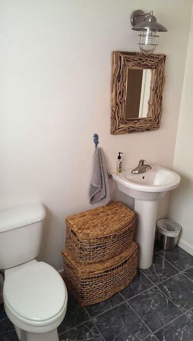 Small powder room with basket storage