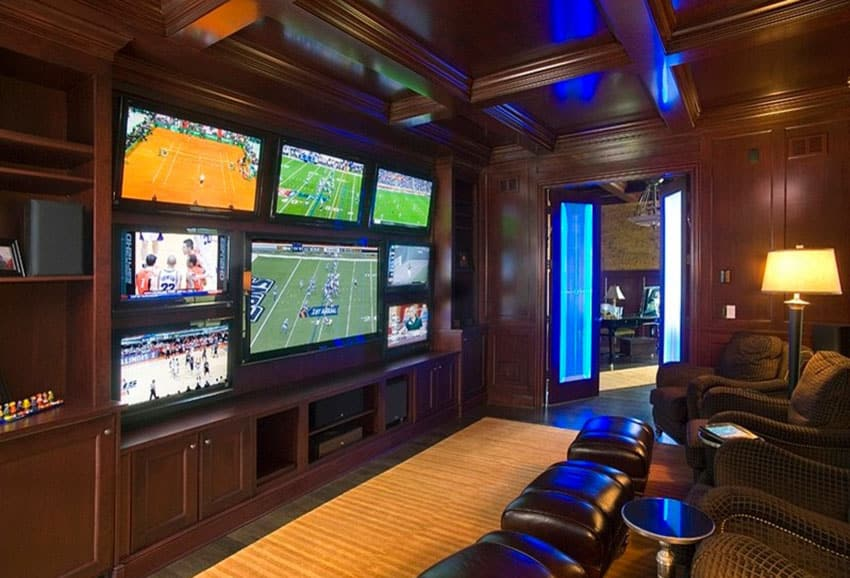 Sports watching man cave with multiple tv monitors