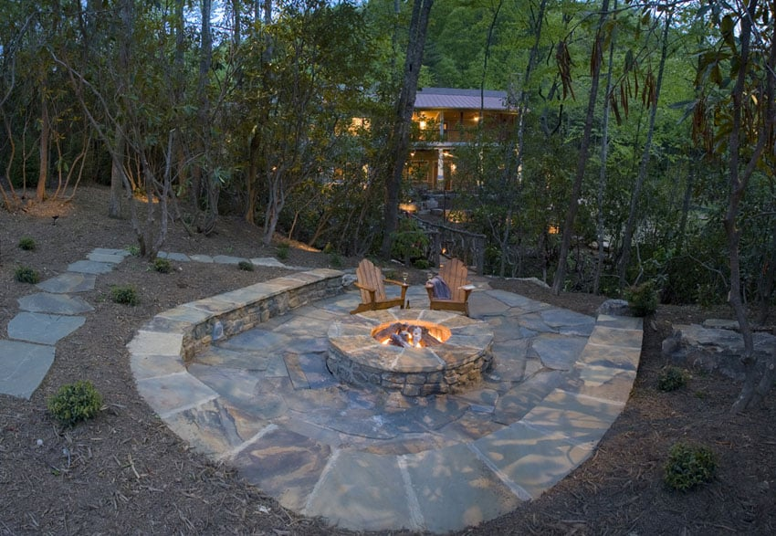 Stone patio with fire pit and stone circular bench seating