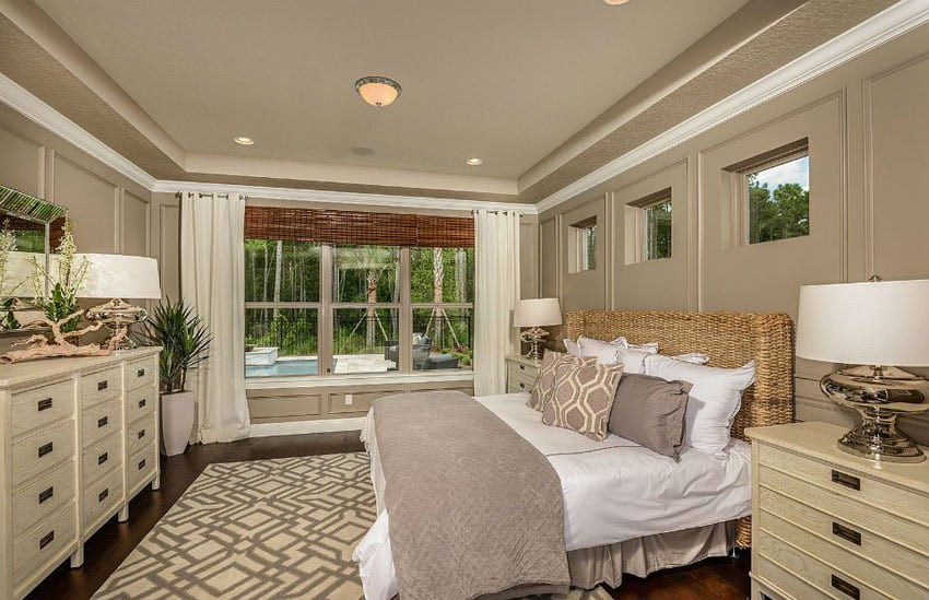 Tan bedroom with wood floors and beige furniture
