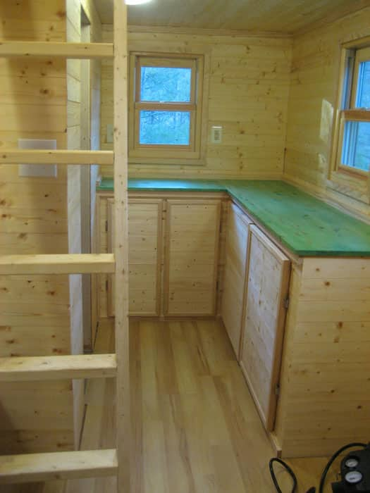 Tiny house interior with ladder to loft bedroom