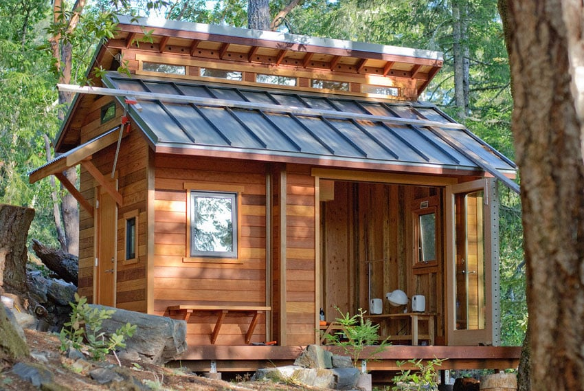 Tiny house with skylights and forest views