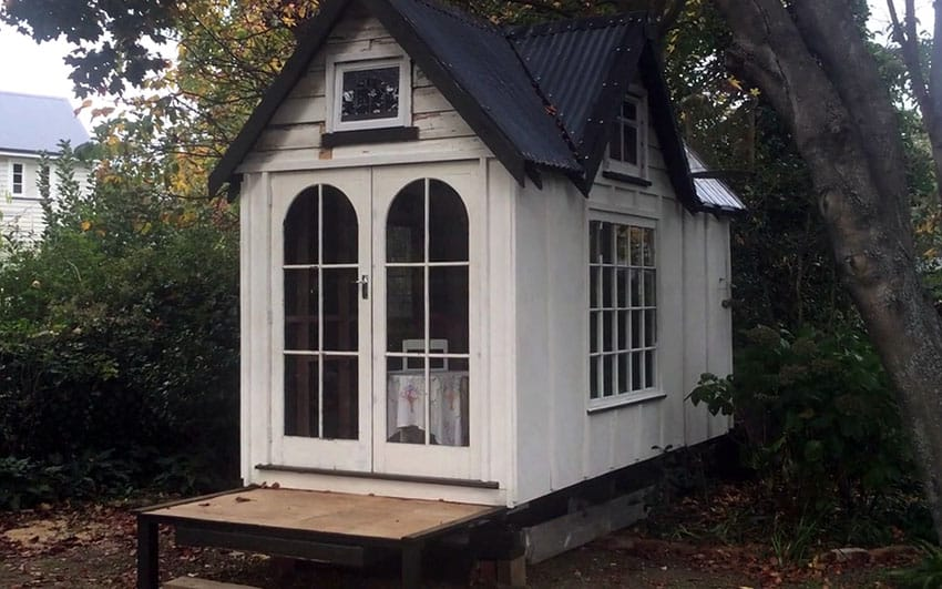 Tiny white house with gable roof