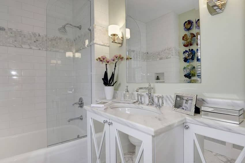 Traditional bathroom with white mirrored vanity and white tile