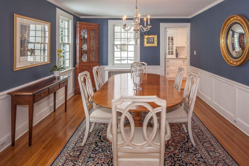 Traditional blue and white dining room with wainscoting and wood floors