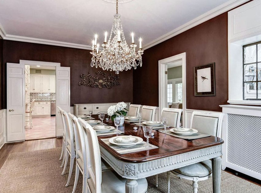 Traditional dining room with dark red and white color theme