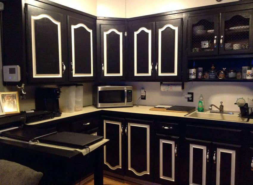Traditional kitchen with black cabinets with white inlay doors