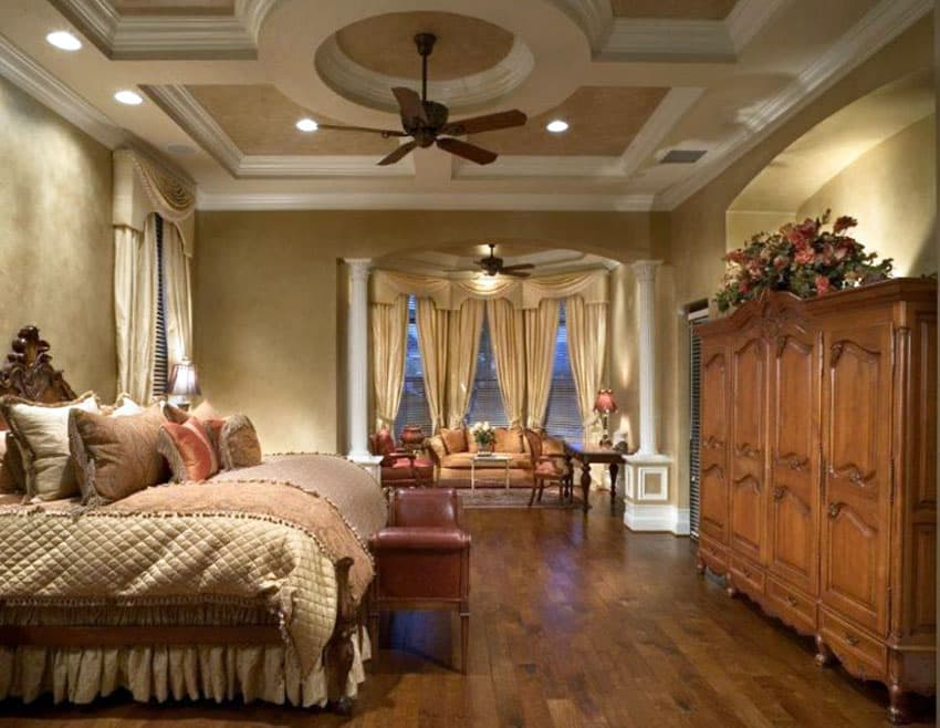 Traditional tan master bedroom with cupola ceiling and sitting area