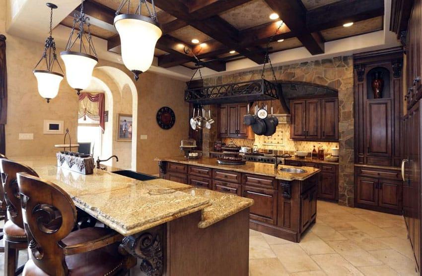 Tuscan kitchen with golden riviera granite countertop island and breakfast bar