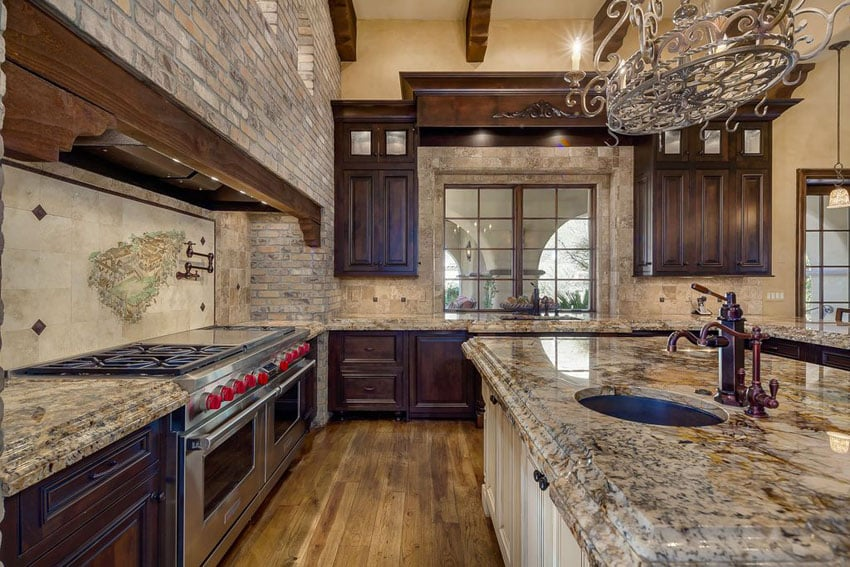 Tuscan kitchen with rustic brick walls and azurite granite countertops
