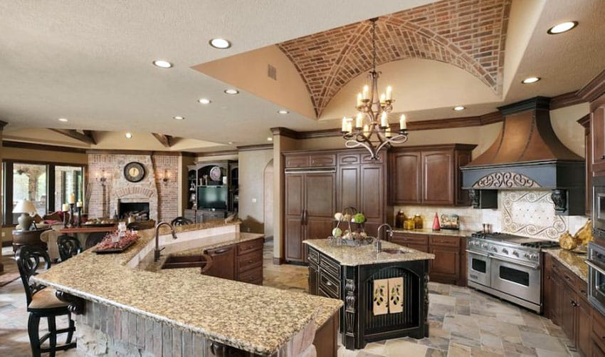 Tuscan kitchen with two islands and venetian gold granite countertops