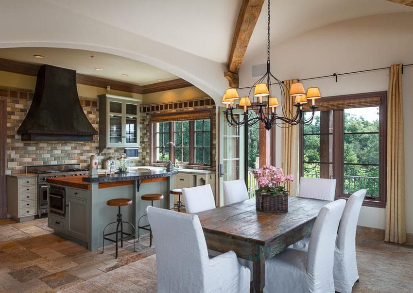 Tuscan style kitchen with breakfast bar island and small dining area