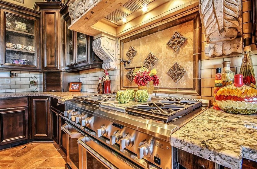 Tuscan style kitchen with dark cabinets and barricato granite counters