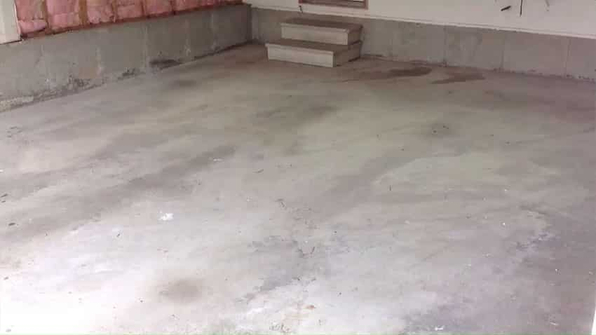 Bare garage floor before makeover picture