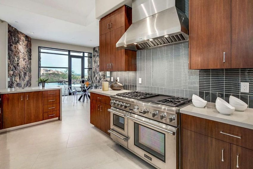 Contemporary brown cabinet kitchen with corian countertops and two types of backsplash