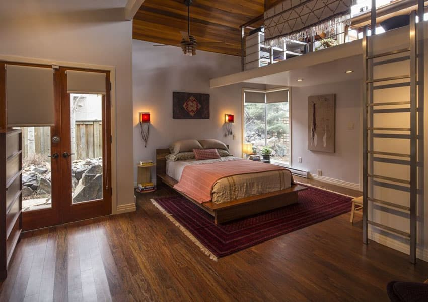 Contemporary loft bedroom with reverse floor plan, ladder and wood floors and ceilings