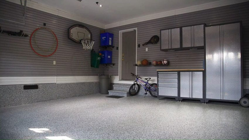 Garage makeover with storage cabinets and finished flooring