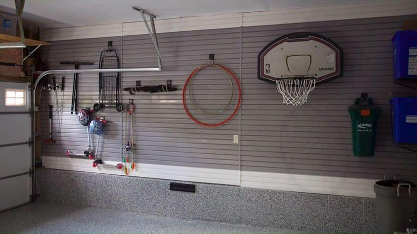 Gray garage with slatwall hanging storage