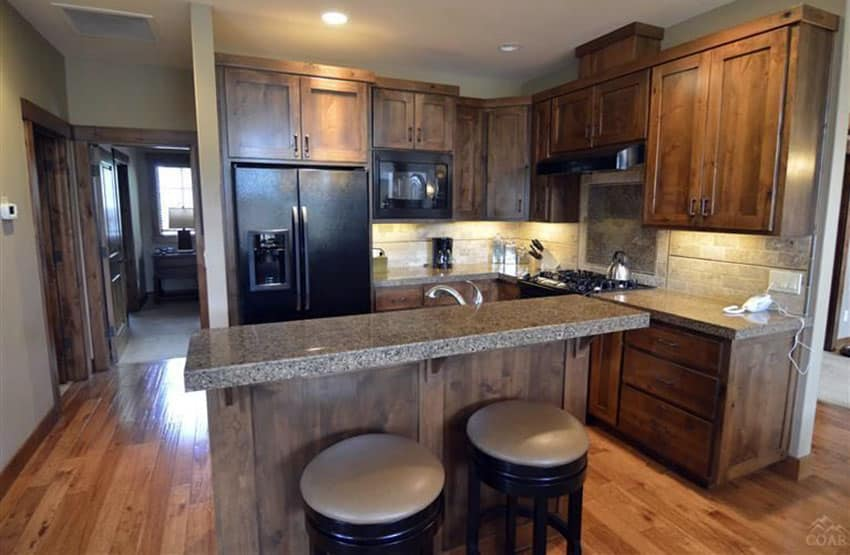 Kitchen with craftsman cabinets small breakfast bar island and hickory floors