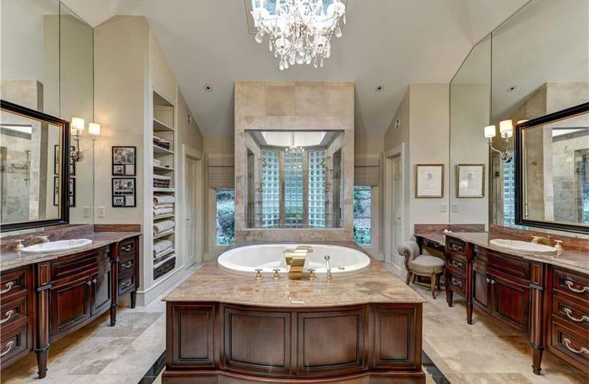 Luxury bathroom with dual dark wood custom vanities, enclosed tub with brown marble surface