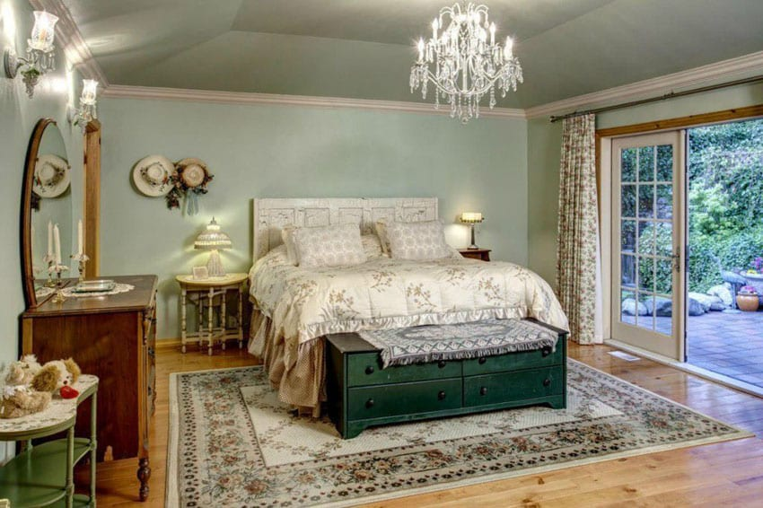 Luxury bedroom with knotty pine floors and chandelier