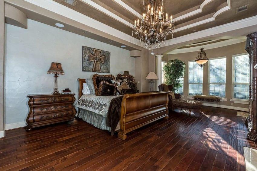 Luxury master bedroom with hickory hardwood floors, chandelier and elegant furniture