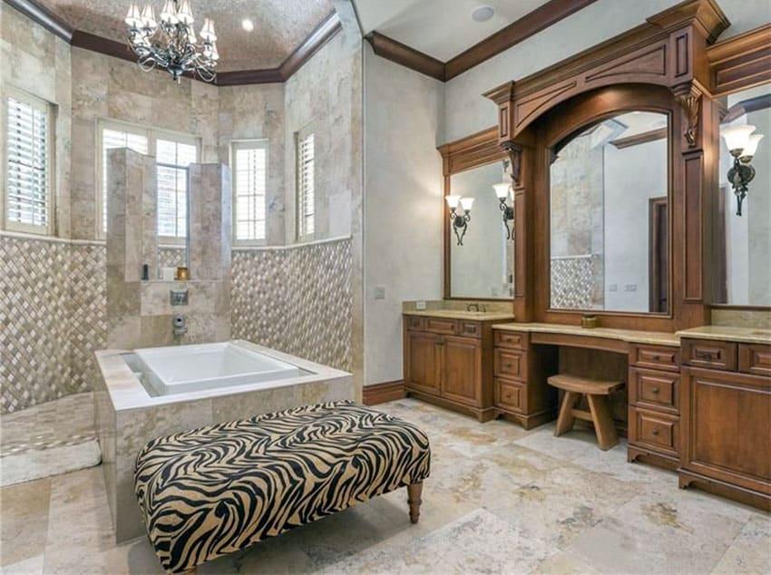 Mansion bathroom with large custom wood vanity and tile bathroom enclosure