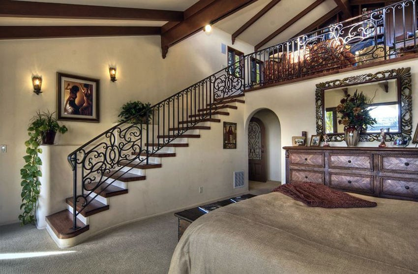 Mediterranean style loft bedroom with wrought iron staircase