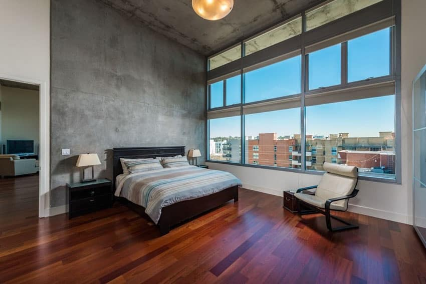 Modern bedroom with Brazilian cherry wood floors and concrete walls