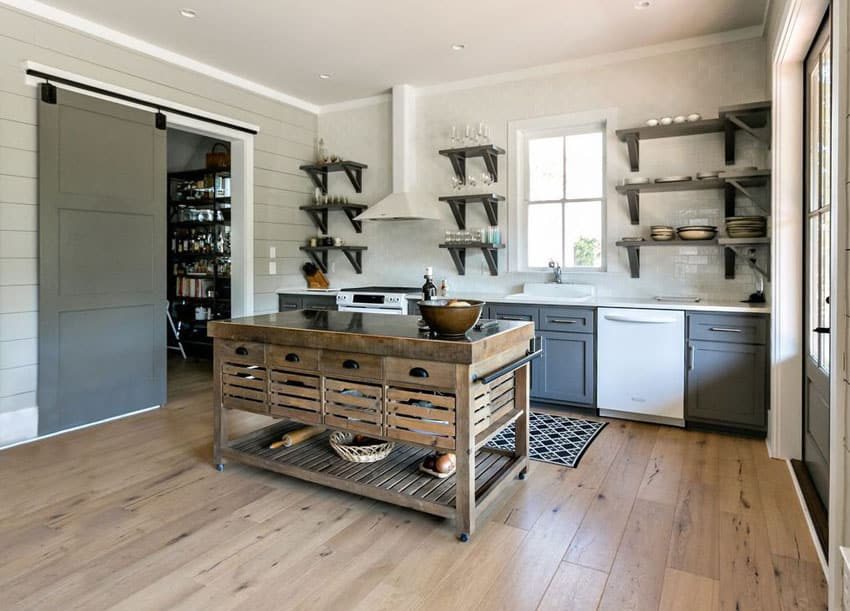 Small craftsman kitchen with portable wood island and sliding barn door